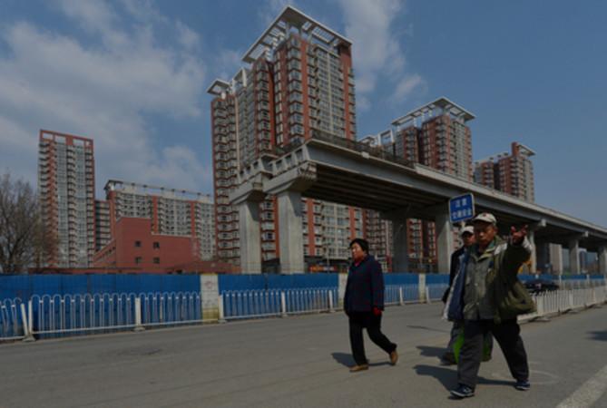 中国国家統計局によると2015年の国内売れ残り分譲住宅床面積は7億1800万平方メートルで過去最高水準となった (Mark RALSTON/AFP)
