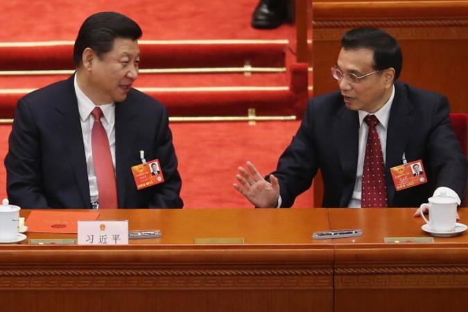 北京の人民大会堂で、2017年3月5日~15日まで開かれた第12回全国人民代表大会。5日の開幕式に参加した習近平国家主席と李克強首相 (Lintao Zhang/Getty Images)