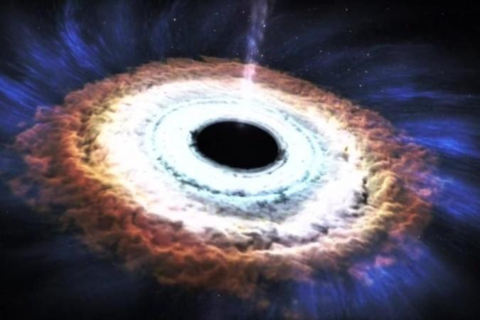 恒星が超巨大質量ブラックホールに呑み込まれ、そして高エネルギー物質が噴出(動画スクリーンショット)