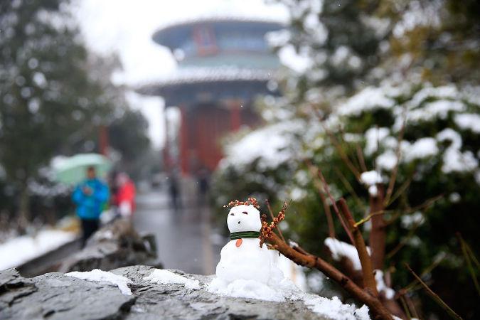 2016年2月20日、旧正月の連休期間に雪の降った北京(Lintao Zhang/Getty Images)