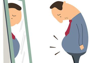 食べ過ぎ、運動不足の男性は余分の脂肪を貯めてしまう(Fotolia)