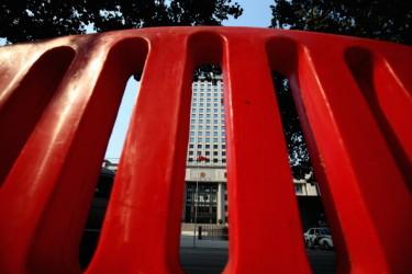 習陣営の腐敗撲滅運動は金融業界(政権の金庫)の粛清へ (Photo by Feng Li/Getty Images)