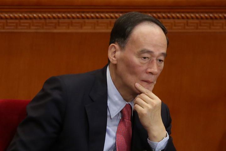 最高指導部からの退任が確実となった王岐山氏(Photo by Feng Li/Getty Images)