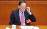 香港メディアによると、24日に閉幕した党大会で最高指導部から退任した王岐山氏は来年国家副主席に就任する。(WANG ZHAO/AFP/Getty Images)