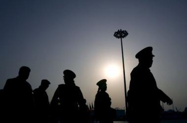中国当局が21日発表した政府機構改革計画によると、気功グループ法輪功を弾圧するために創設された「610弁公室)」に関して、今後司法・検察などを主管する「党中央政法委員会」(政法委)と公安部の指導を受ける。(Getty Images)