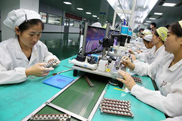 中国当局は国内政府系メディアに対して、報道の際「中国製造2025」との文言を使わないよう要求した。写真は安徽省にある製造工場(Getty Images)
