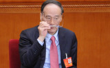 中宣部幹部を批評する中規委トップの王岐山氏(WANG ZHAO/AFP/Getty Images)