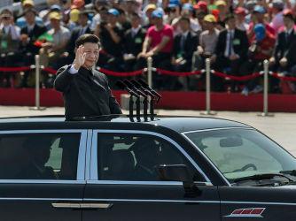 2015年9月、人民軍の軍事パレードに姿を見せた習近平・中国国家主席(Kevin Frayer/Getty Images)