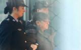 14年の逃亡を続けた浙江省政府の元高官・楊秀珠容疑者が帰国、自首して北京空港で逮捕(CCTVスクリーンショット)