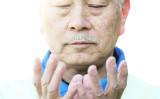 2013年、シドニーで、祈る男性(GettyImages)