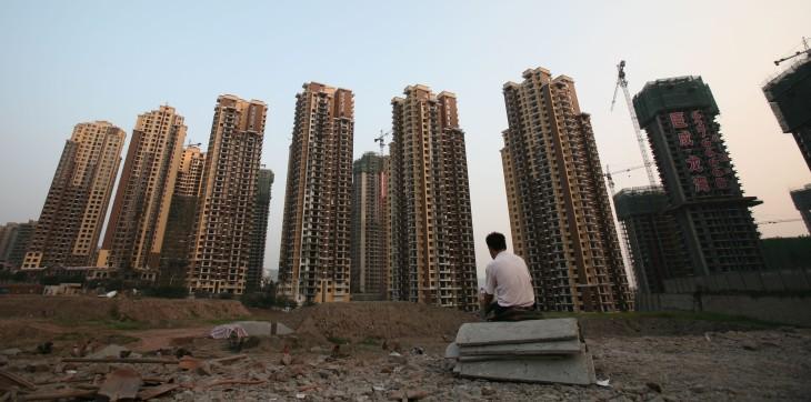 中国不動産開発企業は今年に入ってから、債務返済のため、相次いで融資計画を発表した (Photo by China Photos/Getty Images)