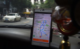 配車アプリのタクシー、イメージ写真(GREG BAKER/AFP/Getty Images)
