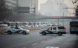 3月27日、北朝鮮の金正恩委員長は、北京の迎賓館である魚釣台国賓館を訪問しているとされ、周辺道路を封鎖する中国警察車両(FRED DUFOUR/AFP/Getty Images)