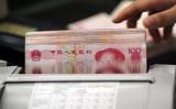 ブルームバーグによると、米財務省高官はこのほど、10月15日に発表予定の為替報告書で中国を為替操作国に指定する可能性を示した(STR/AFP/Getty Images)