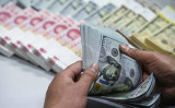 中国人民元は、30日のオンショア市場(CNY)で対ドルで一時1ドル=6.9724元まで下落し、10年ぶりの安値を付けた(大紀元資料室)