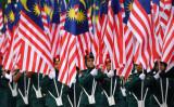 マレーシア共産党は独立に寄与せず武装反乱を起こしていた。写真はマレーシア独立記念日のパレード(Photo by Manan VATSYAYANA / AFP) (Photo credit should read MANAN VATSYAYANA/AFP/Getty Images)