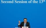 3月15日、全国人民代表大会閉幕後の記者会見に臨んだ李克強首相(Photo by Lintao Zhang/Getty Images)