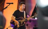 中国の民謡歌手の李志氏(大紀元資料室)
