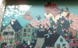 『ガリヴァー旅行記』に描いてされる場面:リリパットの市民に囲まれたガリバーを描いた壁画(Wikimedia Commons / イメージの作者:User:Javier Carro / 壁画の作者:未知 / CC BY-SA 3.0)