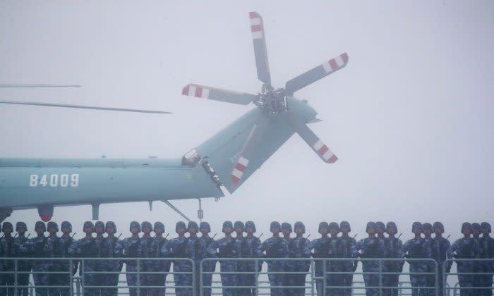 台湾兄弟、日米最新ミサイルやF35戦闘機などの情報を盗むスパイ 中国軍から資金=FBI(GettyImages)