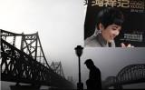 米司法省は23日、対北朝鮮制裁に違反したとして中国丹東鴻祥実業有限公司と馬暁紅会長ら4人を起訴した(Getty Images、大紀元合成)