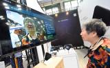 英FT紙によると、中国通信企業は国連の顔認証技術の国際標準に協力している(STR/AFP/Getty Images)