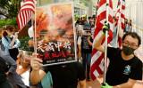 9月20日、香港市民は「天が中国共産党を滅する」と書かれたプラカードと米国旗を掲げて、米国に「香港人権・民主主義法案」の早期可決を求めた(宋碧龍/大紀元)