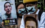 国際人権団体フリーダム・ハウスは年次報告で、中国共産党はますます抑圧的になっていると分析した。写真は2月19日、武漢の病院を独自報道したことで拘束された市民ジャーナリストの解放を訴える香港市民(GettyImage)