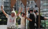2014年7月、米ワシントンで行われた、中国本土における法輪功迫害について周知を狙うデモンストレーションの様子(Getty Images)
