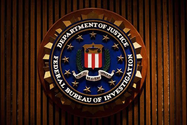 写真は米国司法省のロゴマーク(GettyImages)