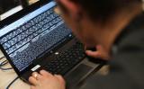 サイバー攻撃のイメージ写真(THOMAS SAMSON/AFP)