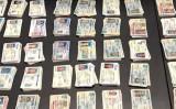 写真は昨年秋、米税関が押収した中国からニューヨークに送られた偽造運転免許証 (大紀元)