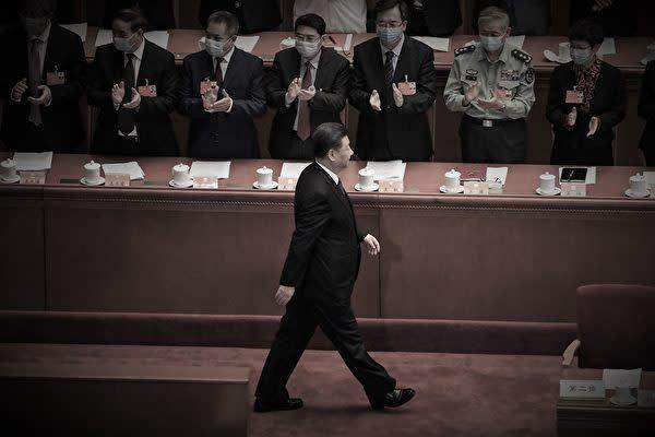 写真は、2020年5月21日の中国共産党の両会の開会式(Leo RAMIREZ/AFP)