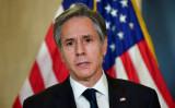2021年3月19日、アラスカのアンカレッジで2日間の米中会談を終え、メディアに話すブリンケン米国務長官(Frederic J. Brown/POOL/AFP via Getty Images)
