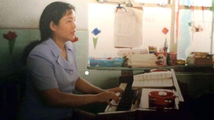 中国武漢市に住む法輪功学習者の黄時群さん(明慧網)
