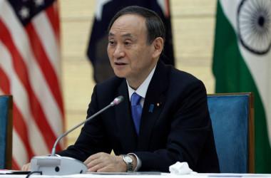 3月21日、日米豪印の4カ国戦略枠組み「クアッド」オンライン会議に臨む菅義偉首相(Getty Images)