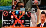 2020年6月30日、ニューデリーで行われた中国共産党機関紙「環球時報」に対するデモで、中国製アプリの削除や中国製品の使用停止を市民に求めるジャーナリスト (Prakash Singh/AFP via Getty Images)